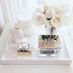 17 gorgeous makeup storage ideas | beauty | vanity organization ideas | white tray, flowers, and candle for a clean minimalist look