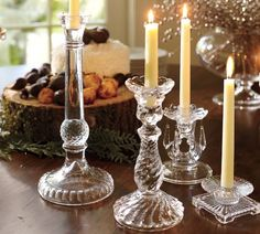 Another cute idea for a centerpiece - mixed candle holders.  Should be easy to find and inexpensive at an antique shop or Goodwill.