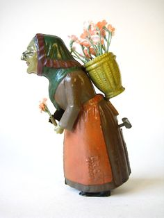 Gunthermann Lady and Flowers  Wind up toy from 1890s/ebay