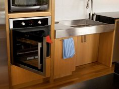 Side-opening oven and custom sink with knee clearance