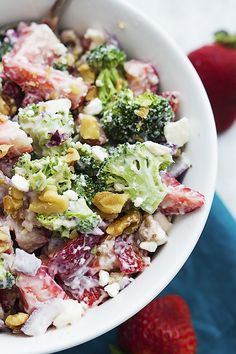 Fresh strawberry broccoli salad with crunchy walnuts, feta cheese, red onions, and a sweet and tangy dressing!