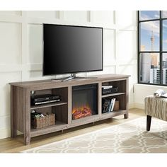 Create a warm, entertaining space in any room of your home with this wood media stand with electric fireplace. Features adjustable shelving to fit your components and a cable management system.
