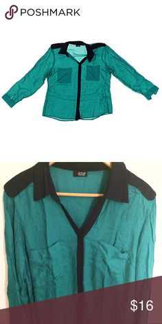 Green/turquoise & black button down shirt Gorgeous color. Black accents on collar and down buttons. Excellent condition! Rayon material so it's lightweight and cool. Super soft and feels good against the skin. Measures 25.5 length and 21 inches in width. ANA Tops Button Down Shirts