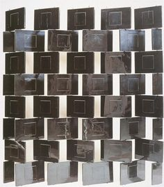 """The """"Brick Screen"""" produced from wooden blocks in Japanese lacquer pivoting on steel rods. This particular piece was owned by Gray's friend and paramour Jean Badovici 