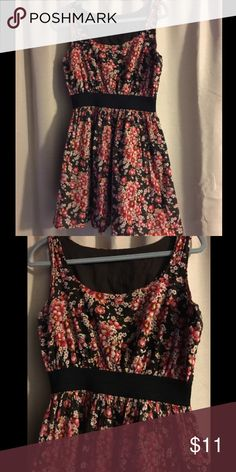 Cotton Floral Dress Size Medium This cotton dress is lined. It is brown, red and cream flower print. It has a visible black  elastic waist in the middle. The dress is lined. It is made of 100% cotton. Size Medium unbranded Dresses Mini