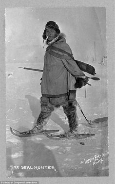 An Inuit/Aleut/Yupik (not certain which Nation) Hunter: A seal hunter is seen walking on land, his snow shoes helping him easily slide across the frozen land