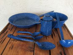 Vintage blue Graniteware, 7 pieces in all. Good vintage condition with expected wear & dings to enamel, some rust, a few dents. Very rustic - great to use on camping trips, in a mountain cabin, or to decorate a primitive farmhouse kitchen. Included in lot: 1 skillet 12 diameter x 2 deep 1 pot 8 1/2 diameter x 2 1/2 deep 1 coffee pot 4 diameter x 5 tall 1 ladle 3 1/4 diameter x 1 1/2 deep x 12 long 1 spoon 14 long 2 spoons 8 1/4 long            ERUT