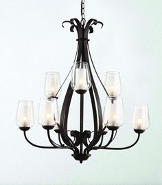 Gracie 9-Light Chandelier with Oil-Rubbed Bronze Finish with Clear Glass around inner Frosted Glass