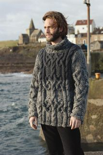 Knit this mens cable sweater from Rowan Knitting & Crochet Magazine 52 online, a design by Marie Wallin using the ever popular yarns Big Wool and Drift (merino wool). With a drop shoulder, straight cast-off sleeves and colour block detail, this knitting pattern is for the intermediate knitter and is a free pattern to download.