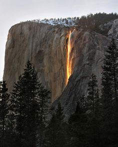 "Horsetail Fall is a small, ephemeral waterfall that flows over the eastern edge of El Capitan in Yosemite Valley. For two weeks in February, the setting sun striking the waterfall creates a deep orange glow that resembles Yosemite's historic ""Firefall."""