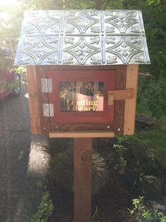 """Christine Webb. Beaverton, OR. I recently reconnected with my english teacher from high school. She is an author (booksbycarolinemiller.com) and while reading one of her blogs I discovered that neighborhoods all over the city hosted little boxes that could be filled with books to share. My family and I thought this was a fantastic idea and built our little lending library """"The Read Box Lending Library."""" Thank you, Miss Miller, for sharing this idea, and for remembering."""
