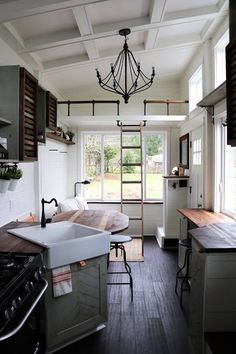 """TINY GETAWAY HOUSE  27"""" Farmhouse style apron front sink with coordinating faucet Integrated pull-out drawer for garbage and recycle receptacles"""
