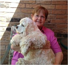 June Myers doesn't consider herself a hero, but she gives freely of herself to help animals in need in Oklahoma. Here, she snuggles with her blind Cocker Spaniel, Buster.