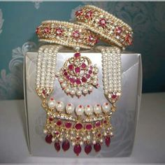 The classic and vintage pearl, ruby & diamond set