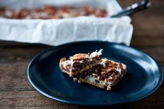 Magic Cookie Bars with Dates from Eclectic Recipes (http://punchfork.com/recipe/Magic-Cookie-Bars-with-Dates-Eclectic-Recipes)