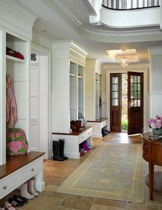Kate Coughlin Interiors: Amazing mudroom with built-in cabinets and Persian rug over travertine tile floor. White ...