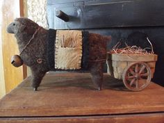 Brown Wool Sheep Pulling Primitive Wagon