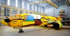 Art Duo Os Gêmeos Spray Paints Brazilian Soccer Team's Boeing 737 With Giant Street Art Mural for 2014 World Cup