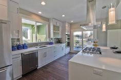Photo of Pius Kitchen & Bath - Seattle, WA, United States. White Flat Panel Acrylic Cabinets with Pure White Quartz Countertops in Seattle