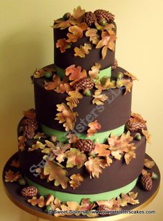 Fall Wedding Cake..Sugar leaves,acorns and pine cones with a twist..ganache icing! walking on sunshine:-)