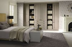 Pendle Jute Grey Shaker Bedroom - Modern feature wallpaper - Fireplace - Intergrated open book shelving - Area carpet - Bedside table cabinets | Atlantis Kitchens | Bedrooms