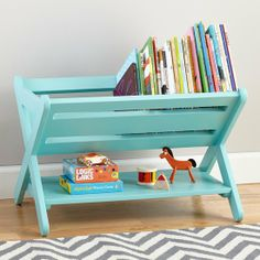 "The Land of Nod Good Read Book Caddy: If your kids are the throw-and-go type, The Land of Nod's ""a href=""http://www.landofnod.com/good-read-book-caddy-azure/f12250"">Good Read Book Caddy ($149) is an easy book-storage option, allowing kids easy access to their books — and making it easy for them to reshelve when they're done reading. Available in five colors to match any room."