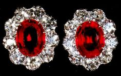 Queen Mary's Cluster Earrings - For her fifty-ninth birthday, on 26 May 1926, King George V presented Queen Mary with these earrings - large oval rubies each set in a cluster of nine brilliant-cut diamonds. Later that year, the Queen officially added them to the other pieces of ruby jewellery left to the Crown by Queen Victoria and King Edward VII.