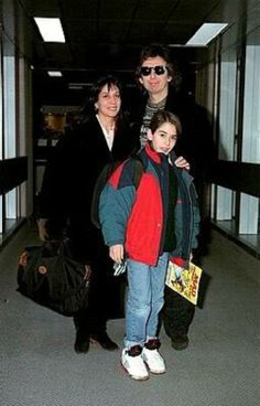 Olivia Arias-Harrison, George Harrison, and Dhani Harrison (going on vacation)