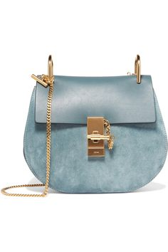 Pale-teal leather and suede Pin and clasp-fastening front flap Designer color: Cloudy Blue Comes with dust bag Weighs approximately 2lbs/ 0.9kg Made in Italy