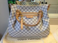 Louis Vuitton Damier Azur Evora Mm Tote Handbag Hobo Shoulder Bag. Get one of the hottest styles of the season! The Louis Vuitton Damier Azur Evora Mm Tote Handbag Hobo Shoulder Bag is a top 10 member favorite on Tradesy. Save on yours before they're sold out!