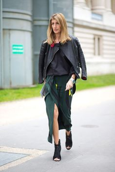 Everyone loves a good layered look. Take a cue from this British fashion buyer and slip on a silky wrap skirt with a loose cropped tank top and a leather moto jacket casually draped over the shoulders.