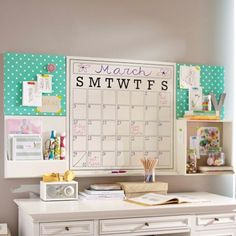 Just white board above desk (in pink photo frame)