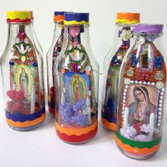 A Mexican shrine in a bottle conveys the admiration of the Virgen de Guadelupe through color, glitter, candles, flowers and shine! The goodies inside are different on both sides. Each bottle is one of
