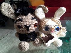 "Bunnirias & Tikabunny of LIndsay Buroker's novel ""Encrypted"".  Until now, Bunnirias was imprisoned on dreadful Krydesk Island, but since Tikabunny is now crocheted as well, the two of them escaped...  I'm sorry that the Admiral had to endure Krydesk that long, but it took time to hunt down the glasses, find the right eyes, bind the book and write its content. ;)"