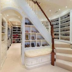 Closet:  It's always nice to have a built in bench in a closet so that you can sit to tie shoes.  This one has storage inside.  Gotta love a 2 story closet.  Do you send the hubby upstairs?