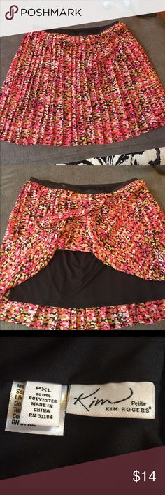 """Bright and colorful pleated skirt Pleated skirt. Colorful dot print. Hot pink, light pink, orange, yellow. Black background.  Black slip underneath.  Hits at/below knees.  It hit right below mine and I'm 5""""2. Kim Rogers Skirts"""