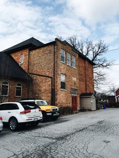 This is our headquarters! The building used to be a high school. It has wonderful old wooden floors and exposed brick. Toronto Architecture, Exposed Brick, Wooden Flooring, Software Development, App Design, Exterior Design, Floors, This Is Us, High School