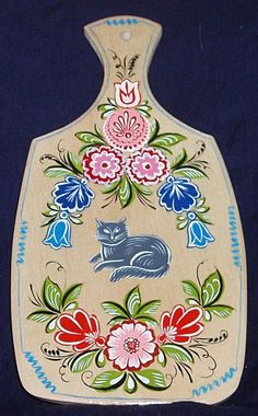 A wooden chopping board with folk Gorodets painting from Russia