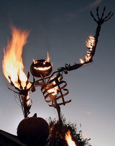 Incredible Halloween décor.  Metal flame-throwing Pumpkin Man.