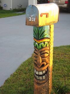 tropical mailbox and posts Tropical Mailboxes, Tiki Decor, Outdoor Decor, Tiki Art, Tiki Tiki, Unique Mailboxes, Tiki Head, Tiki Totem, Tiki Lounge