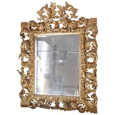 Heavily Carved and Gilt Italian Baroque Mirror available for sale at Atelier1505.com