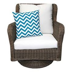 """Indoor/outdoor arm chair with a swiveling base and Sunbrella cushions.   Product: RockerConstruction Material: Polyethelene, powder coated aluminum and sunbrellaColor: BrownDimensions: 36"""" H x 30"""" W x 36"""" DNote: Accent pillow not includedCleaning and Care: Frame can be cleaned with a mild detergent and water. Upholstery can be machine washed and air dried."""