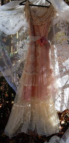 Blush wedding dress dress handmade by vintage opulence on Etsy  The top is a blush pink satin with antique lace around the low neckline and a