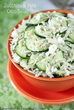 Zucchini, Feta and Lemon Orzo Salad - Orzo pasta tossed with thin slices of raw zucchini and crumbled feta all dressed up in a sunny lemon dressing for a Greek twist on pasta salad.
