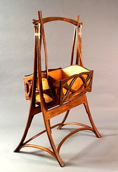 Art nouveau cradle, I would never take this down! Even with no little babies! I would put a beautiful doll in it! Haha!