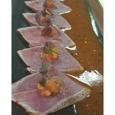 Seared Tuna Tataki with red chilli salsa on top and spicy miso sauce on the side. #sushi #tuna #tataki #tunatataki #chilli #salsa #sisho #cress #spicy #miso #sauce by danielcortez7
