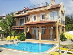 Stunning 4 bedroom duplex apartment with shared pool in fantastic location close to the famous Olu Deniz Beach.