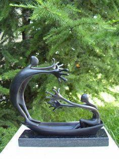 #Bronze #sculpture by #sculptor Plamen Dimitrov titled: 'Striving (Bronze Couple in a Boat statue/statuette)'. #PlamenDimitrov