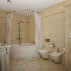 Eye Catching Corner Bathtub Shower Combo In Tub With Curtain Round The House. do not like the wall next to vanity, tub seems closed in. Corner Tub Shower Combo, Corner Jacuzzi Tub, Corner Bathtub Shower, Corner Soaking Tub, Bathroom Tub Shower, Bathroom Ideas, Mini Bathtub, Bathroom Remodeling, Master Bathroom