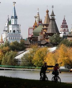 Russia. A couple ride their bicycles during an autumn day in Moscow's Izmaylovsky Park, in Russia, on September 27, 2012. An exhibition and entertainment complex imitating the architecture of old Russian churches and palaces stands in the background